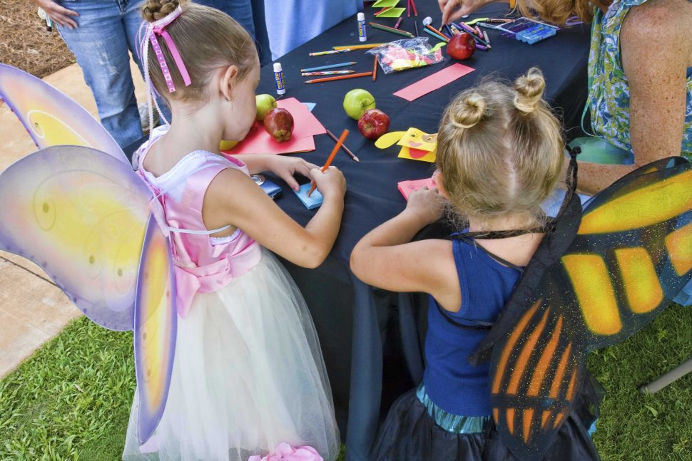 two young girls wearing butterfly costumes at Huntsville Botanical Garden