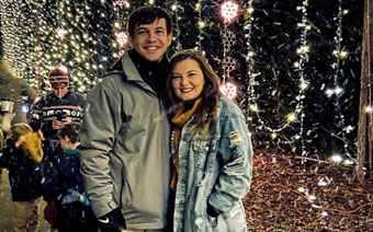 Young couple in the icicle forest during Galaxy of Lights walking nights